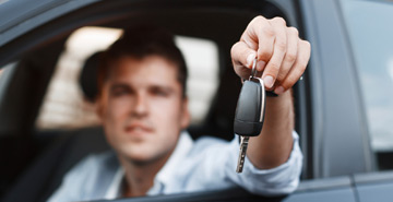 Man holding new car keys